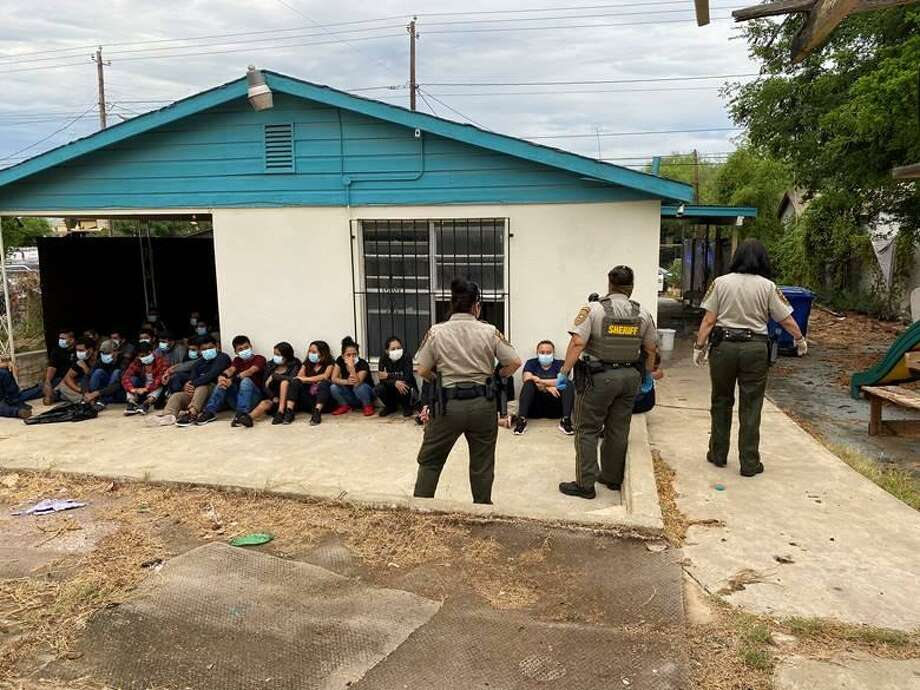County and federal authorities said they discovered more than 40 immigrants and one child inside a stash house located in the 1100 block of East Lyon Street. An investigation is underway. Photo: Courtesy Photo /Webb County Sheriff's Office