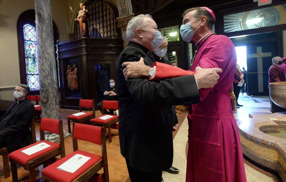 Bishop-elect David Toups warmly greets one of many visiting bishop before the start of the Solemn Vespers ceremony held in preparation for Friday's ordination ceremony. Photo taken Thursday, August 20, 2020 Kim Brent/The Enterprise Photo: Kim Brent / The Enterprise / BEN