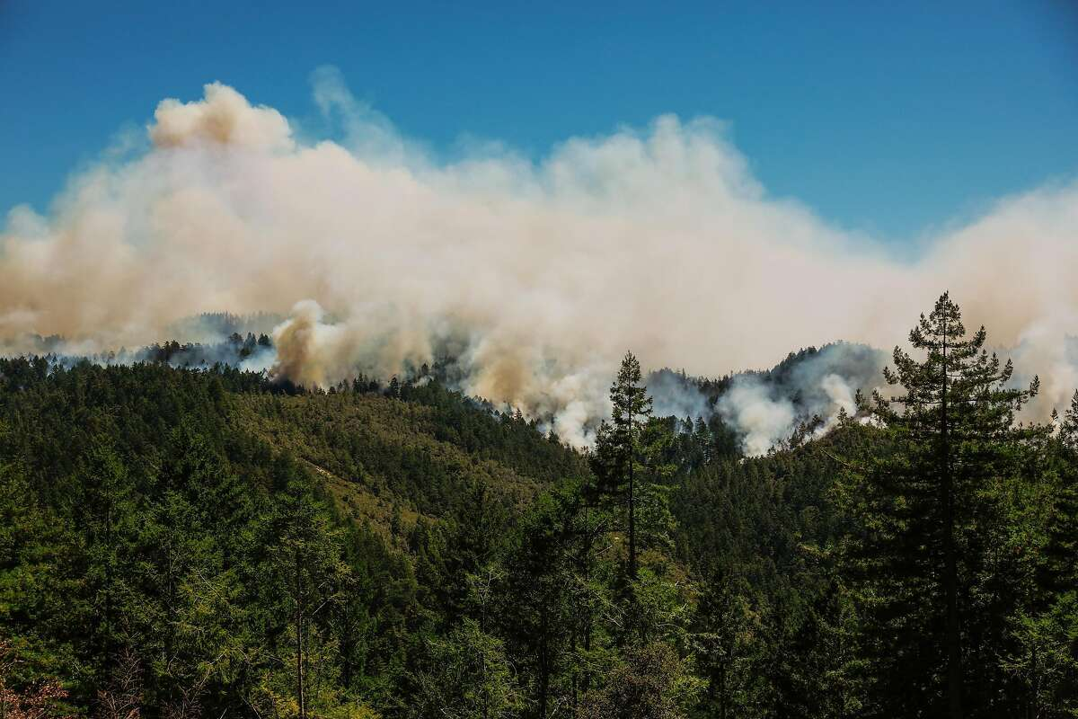Smoke rises from the forest during the CZU Lightning Complex Fire on Thursday, Aug. 20, 2020 in Pescadero, California.