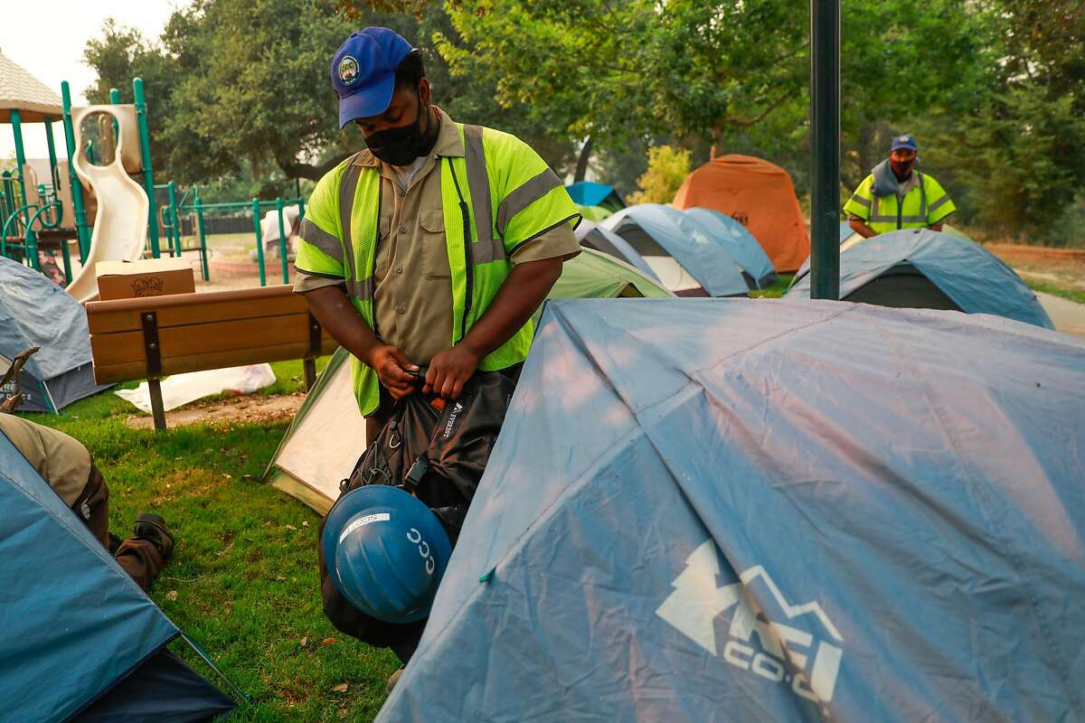 California Conservation Crew member Von Scott (center) prepares to go back to work after resting in a tent during the CZU Lightning Complex Fire on Thursday, Aug. 20, 2020 in Scotts Valley, California.