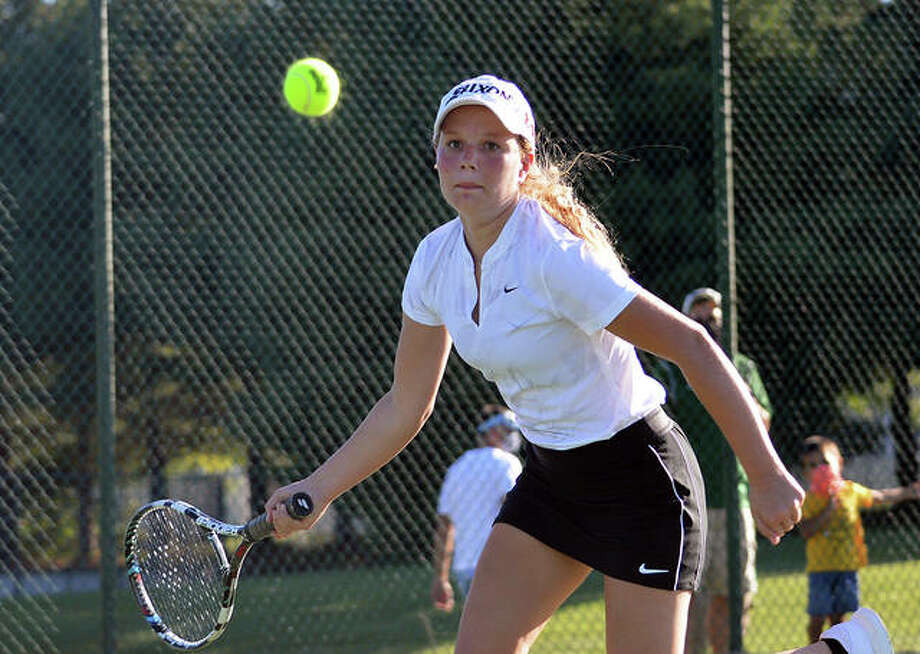Metro-East Lutheran's Grace Hopp keeps her eyes on the ball during her No. 6 singles match against Gibault on Thursday at MELHS. Photo: Scott Marion/The Intelligencer