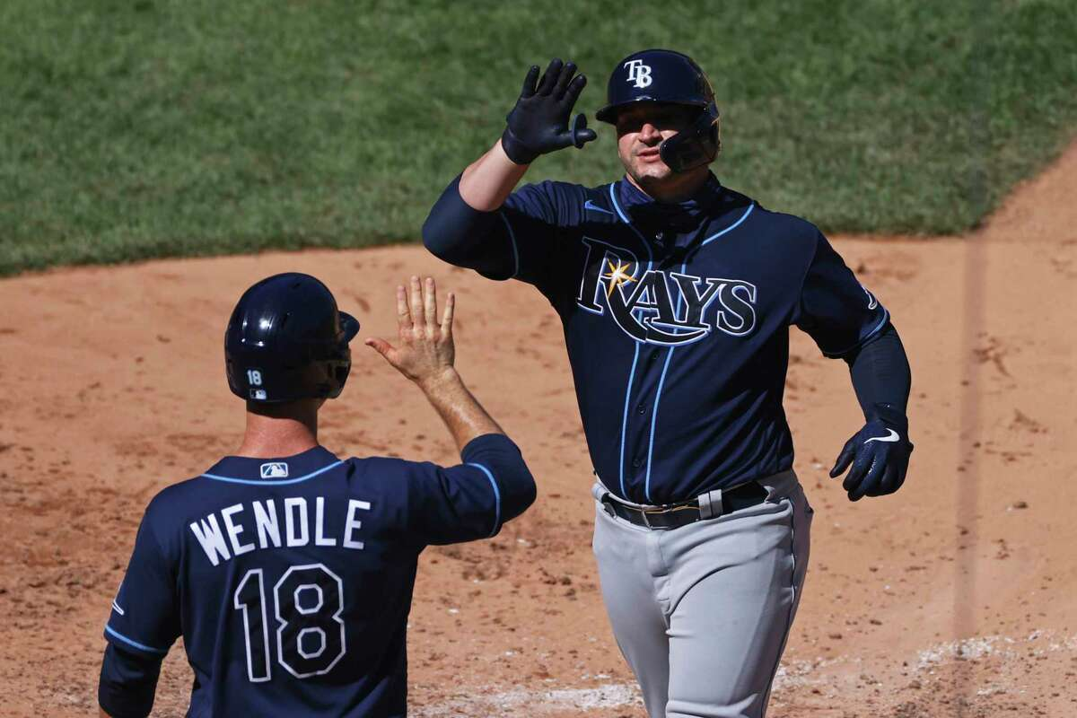 Tampa Bay Rays' Mike Zunino celebrates hitting a three-run home run with Joey Wendle (18) against the New York Yankees during the sixth inning of a baseball game Thursday, Aug. 20, 2020, in New York. (AP Photo/Adam Hunger)