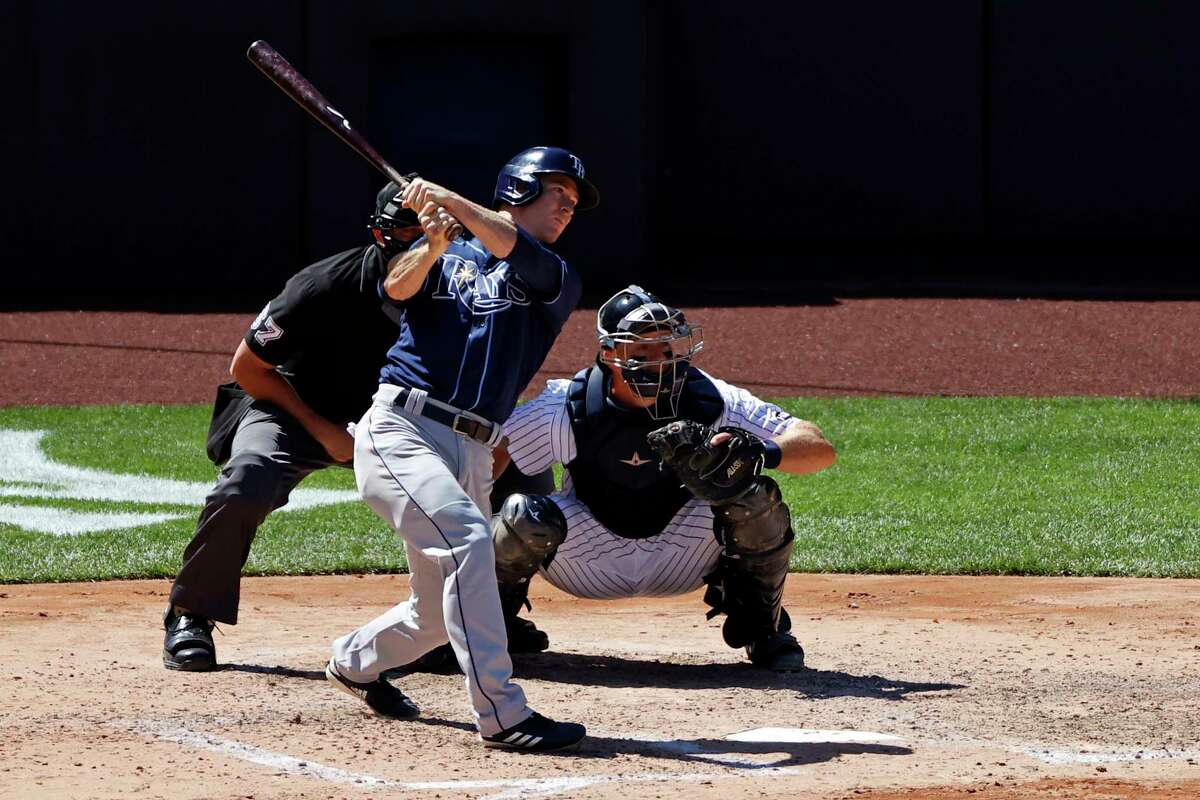 Tampa Bay Rays' Joey Wendle hits a two-RBI double against the New York Yankees during the fifth inning of a baseball game Thursday, Aug. 20, 2020, in New York. (AP Photo/Adam Hunger)