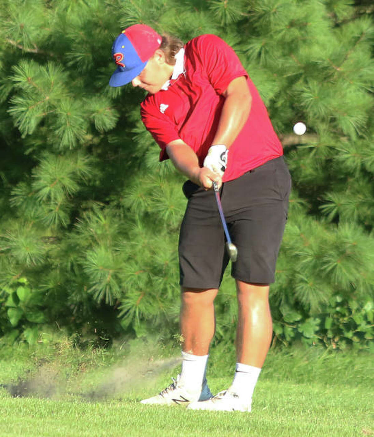 Roxana's Christian Floyd hits toward the green on hole No. 2 in the Madison County Tourney on Thursday at Belk Park in Wood River.