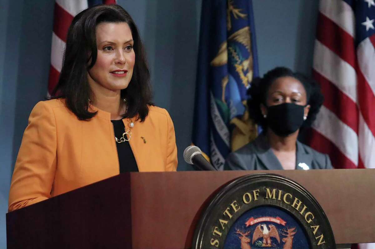 In a photo provided by the Michigan Office of the Governor, Michigan Gov. Gretchen Whitmer addresses the state during a speech in Lansing, Mich., Wednesday, Aug. 19, 2020. Whitmer announced that she will allocate nearly $65 million in federal Coronavirus Aid, Relief, and Economic Security (CARES) Act dollars to Michigan school districts, higher education institutions, and other education-related entities that have been most significantly impacted by the COVID-19 pandemic. (Michigan Office of the Governor via AP)