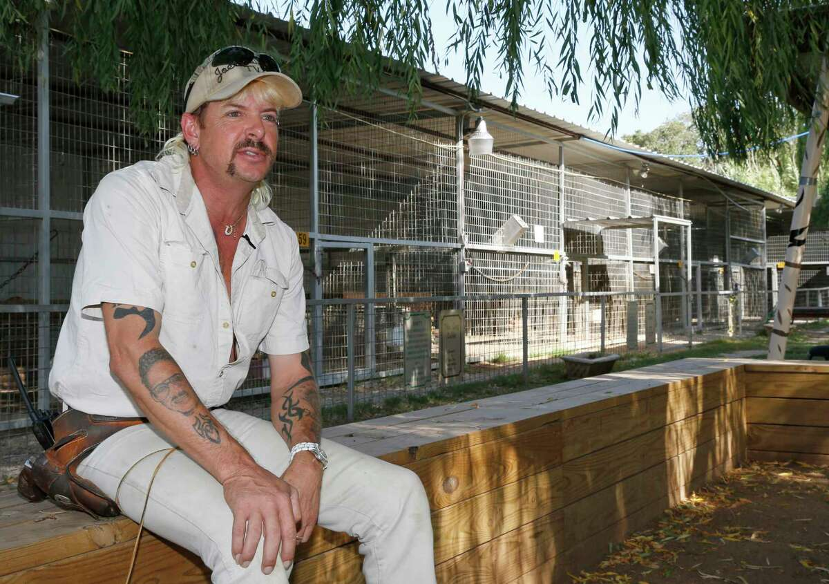 FILE - In this Aug. 28, 2013, file photo, Joseph Maldonado-Passage, also known as Joe Exotic, answers a question during an interview at the zoo he runs in Wynnewood, Okla. The Oklahoma zoo, featured in Netflixa€™s a€œTiger Kinga€ documentary, has closed after federal authorities investigated it for alleged maltreatment of animals and suspended its license. The Greater Wynnewood Exotic Animal Park closed to the public after the U.S. Department of Agriculture on Monday, Aug. 17, 2020, suspended the exhibitor license for current-owner Jeff Lowe for 21 days. (AP Photo/Sue Ogrocki, File)