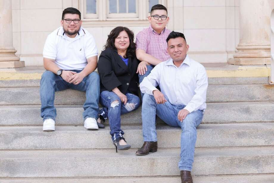 Connie Espinoza (center) started Connie's Compassionate Care with her sons (clockwise from left) Isaac Reyes, Mykeal Espinoza and Pedro Reyes in March 2020. Photo: Connie's Compassionate Care