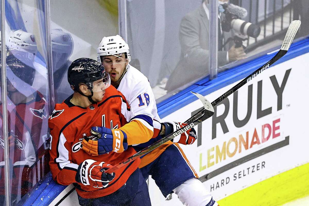 TORONTO, ONTARIO - AUGUST 20: Jakub Vrana #13 of the Washington Capitals is checked by Anthony Beauvillier #18 of the New York Islanders during the first period in Game Five of the Eastern Conference First Round during the 2020 NHL Stanley Cup Playoffs at Scotiabank Arena on August 20, 2020 in Toronto, Ontario. (Photo by Elsa/Getty Images)