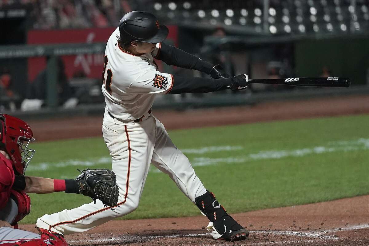 San Francisco Giants' Wilmer Flores hits a two-run single against the Los Angeles Angels during the third inning of a baseball game in San Francisco, Thursday, Aug. 20, 2020. (AP Photo/Jeff Chiu)