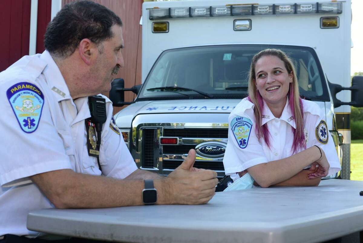 Paramedic Walter Hughes and his daughter EMT Kristina Hughes at Greenwich GEMS station 3 Wednesday, August 19, 2020, in Greenwich, Conn. Walter, a long-term employee of the Greenwich Emergency Medical Service, and his daughter, a recent addition to the team, collaborated on a resuscitation to safe a life last month.