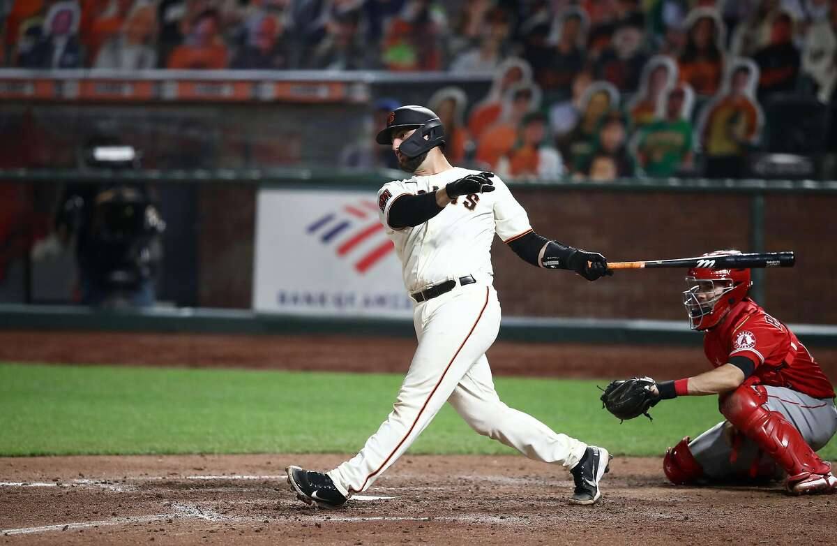 SAN FRANCISCO, CALIFORNIA - AUGUST 20: Joey Bart #21 of the San Francisco Giants hits a double for his first Major League hit in the sixth inning against the Los Angeles Angels at Oracle Park on August 20, 2020 in San Francisco, California. (Photo by Ezra Shaw/Getty Images)