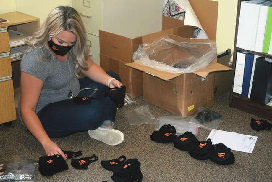 Katie Gardner, Waverly school district's nurse, sorts masks Tuesday in preparation for the start of the school year. Photo: Samantha McDaniel-Ogletree | Journal-Courier