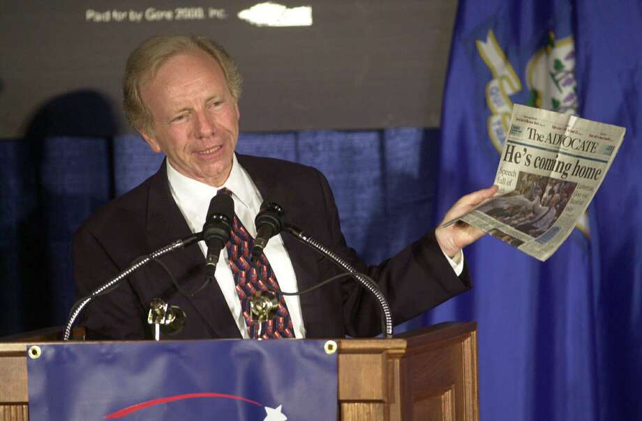 Vice presidential candidate Sen. Joseph Lieberman, D-Conn., holds up a copy of his hometown newspaper, The (Stamford) Advocate, during a campaign speech in Stamford, Wednesday, Aug. 9, 2000. Photo: Bob Child / AP / AP