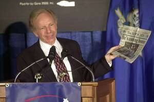 Vice presidential candidate Sen. Joseph Lieberman, D-Conn., holds up a copy of his hometown newspaper, The (Stamford) Advocate, during a campaign speech in Stamford, Wednesday, Aug. 9, 2000.