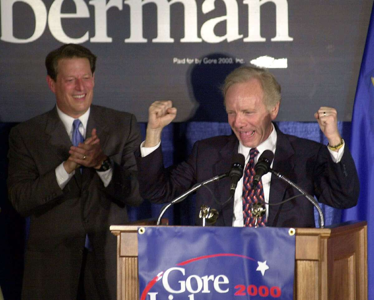Sen. Joseph Lieberman reacts near the end of a campaign speech at the Italian Center in Stamford Aug. 9, 2000, as Democratic presidential candidate Vice President Al Gore applauds. The appearance was Lieberman's first in his home state since being named as Gore's running mate on the Democratic presidential ticket.