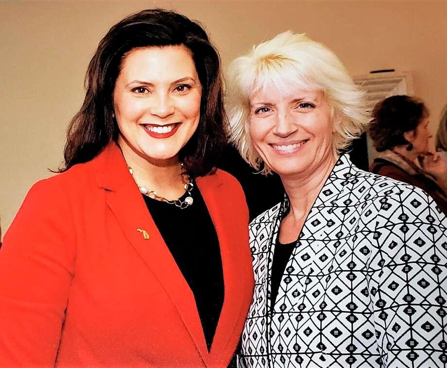 Michigan Gov. Gretchen Whitmer (left) posts for a photo withRep. Annette Glenn, R-Midland. (Photo provided/ Annette Glenn)