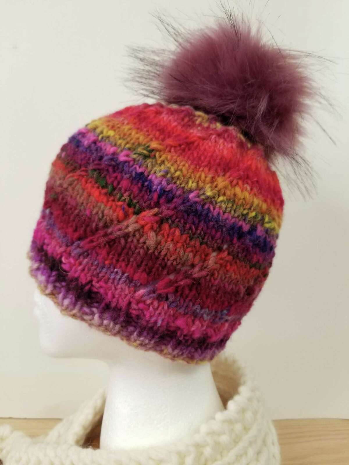 Learn to make fuzzy pompom hats from In Sheep's Clothing in Torrington