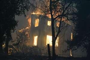 A home burns as the CZU August Lightning Complex Fire passes through on Thursday, Aug. 20, 2020, in Bonny Doon, Calif.