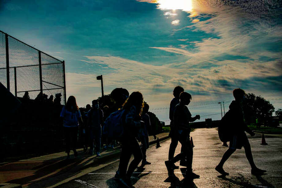 Liberty Middle School students walk to find their appropriate class Friday morning before beginning the new school year. Photo: Tyler Pletsch   Intelligencer