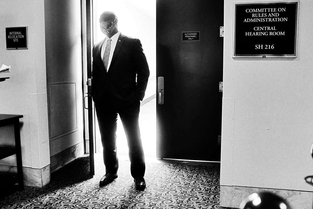 Sen. Tim Scott, R-S.C., heads into a hearing at the Hart Senate Office Building in July.
