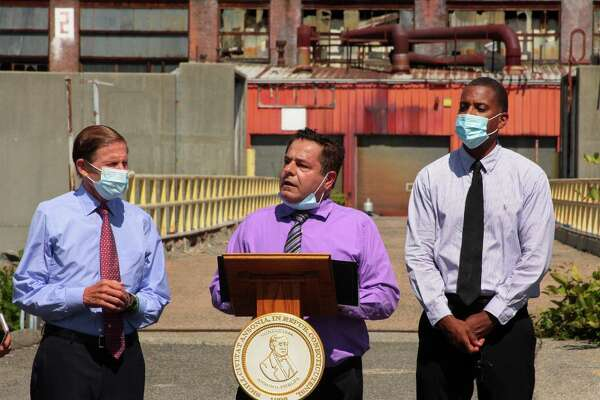A press conference and tour of the former Ansonia Copper and Brass factory complex is held in Ansonia, Conn., on Tuesday Aug. 18, 2020. Mayor David Cassetti, who held the press conference was joined by US Senator Richard Blumenthal, and State Senator George Logan.