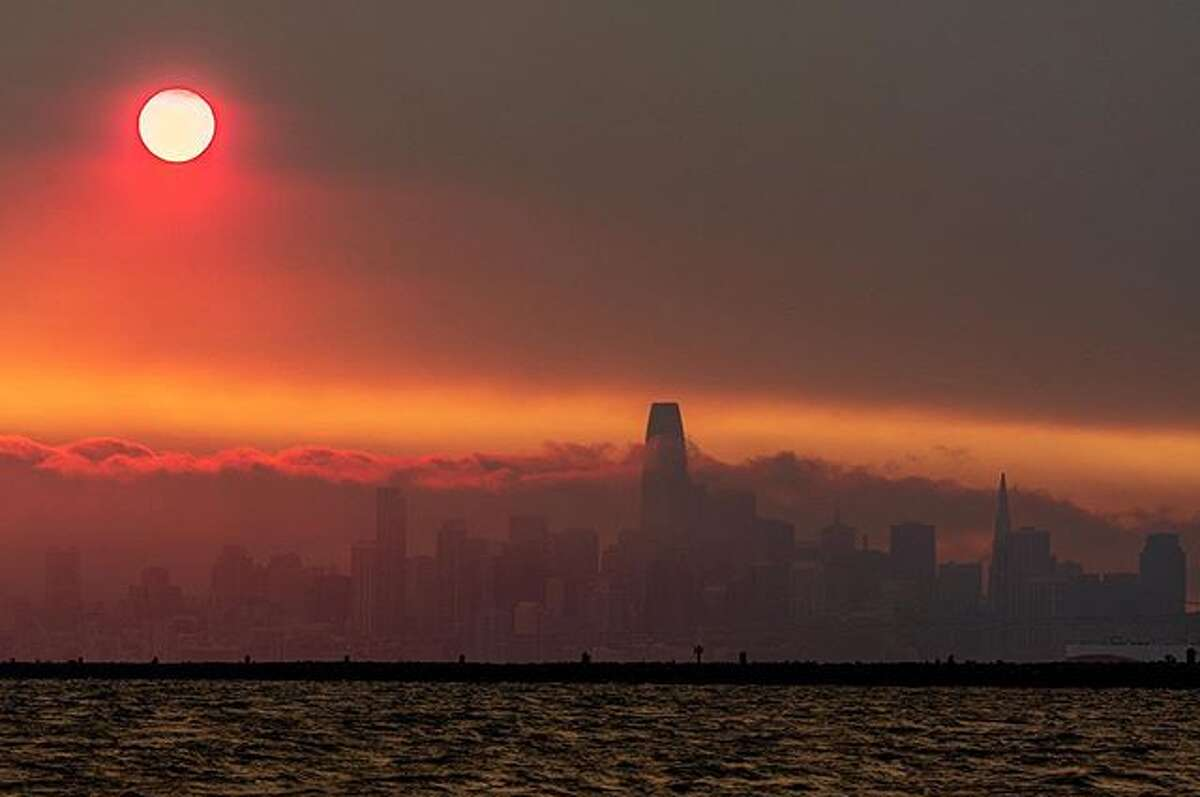 Smoke from wildfires near the San Francisco Bay Area obscure the skyline near sunset on Aug 20, 2020.