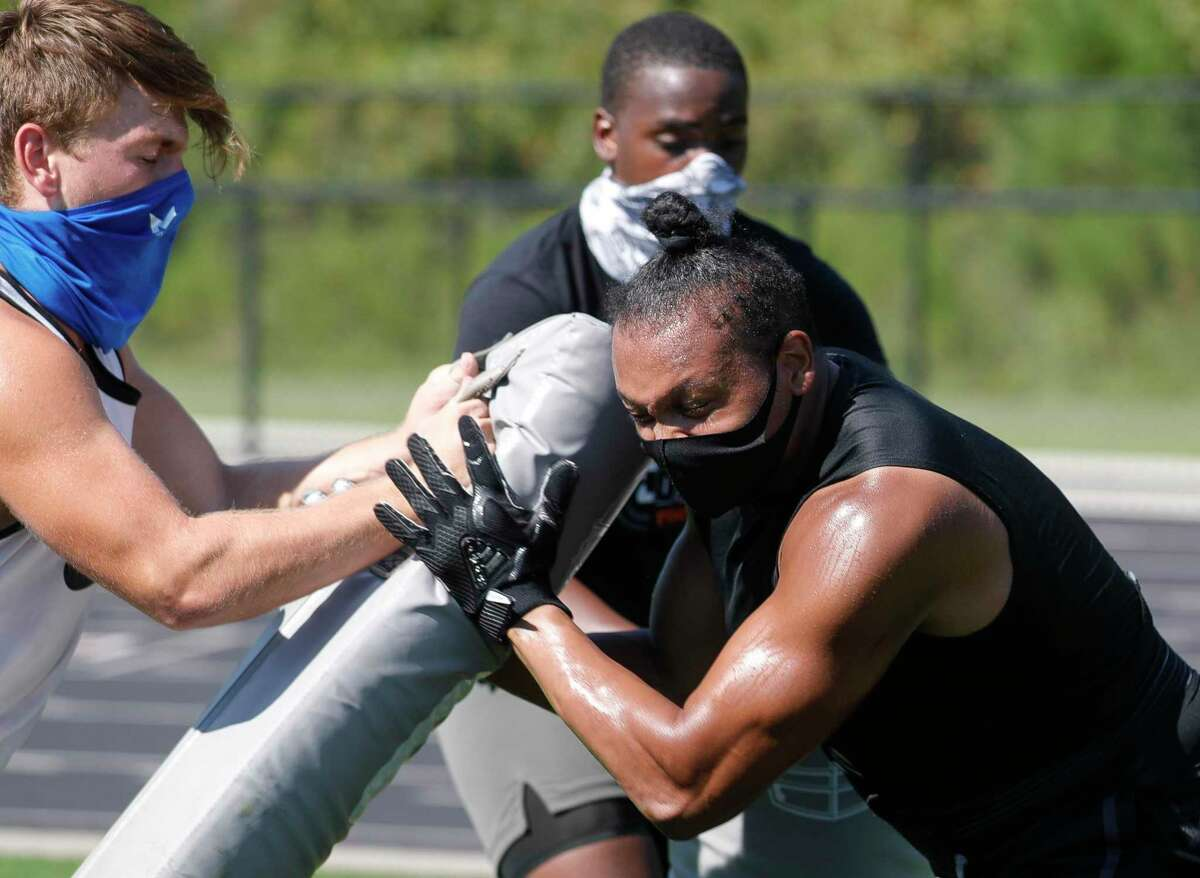 Defensive end Robert Skinner takes part in a drill during a football workout as part of allowed sports-specific training at Grand Oaks High School, Wednesday, Aug. 19, 2020, in Spring.