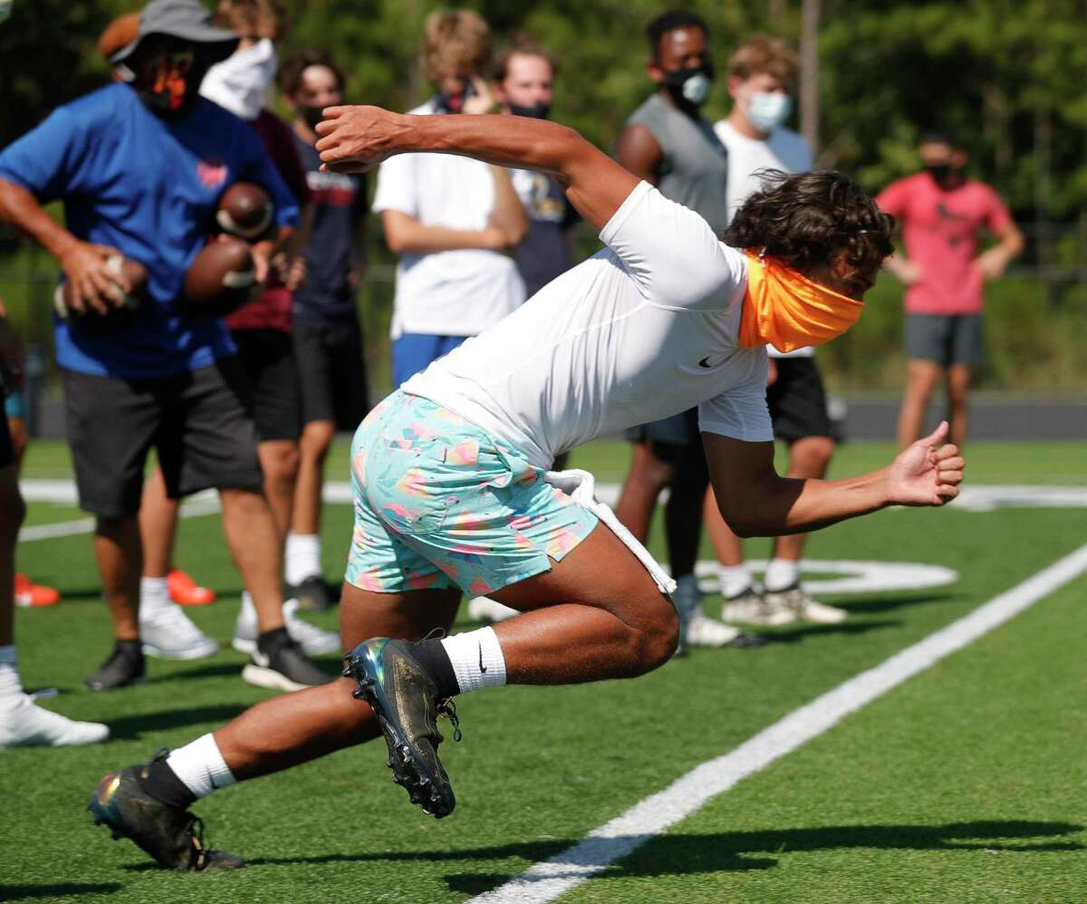 Wide receiver Seth Wright takes off on a route during a football workout as part of allowed sports-specific training at Grand Oaks High School, Wednesday, Aug. 19, 2020, in Spring.