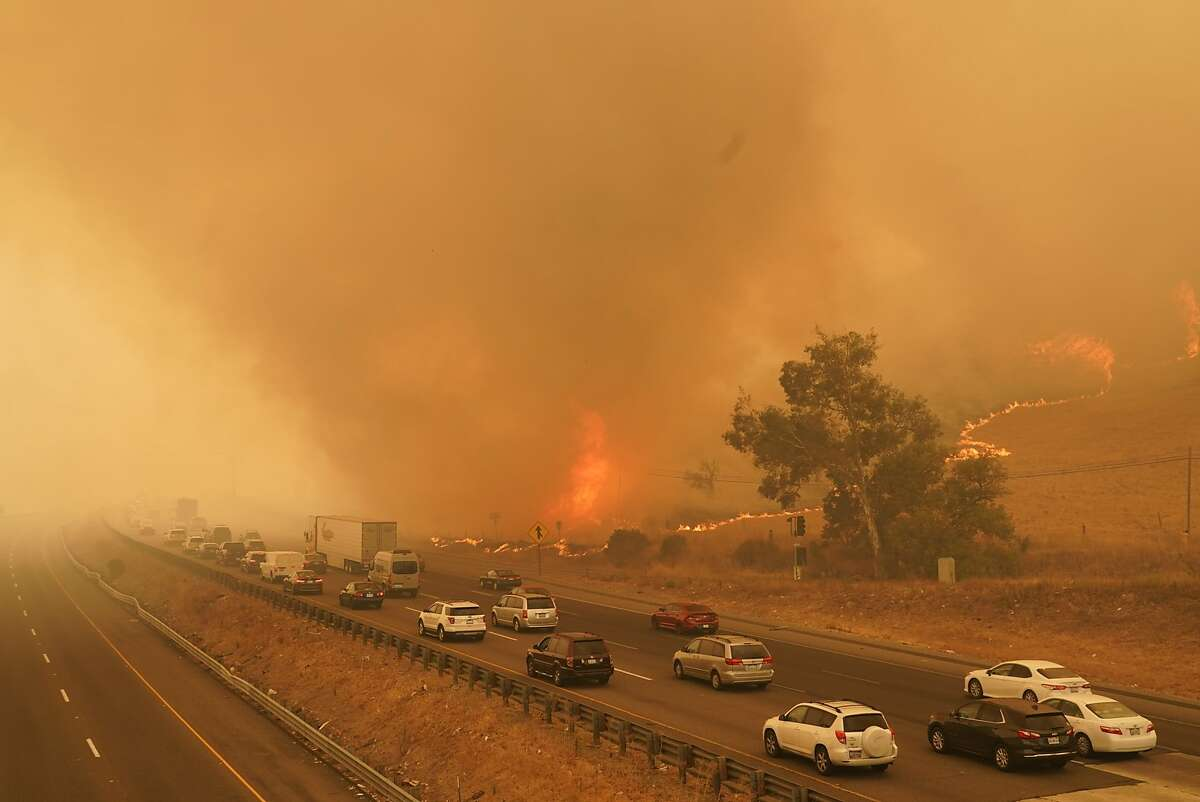 Southbound I-80 slows to a crawl as the fire jumps the freeway during the Lightning Complex fire on Wednesday, August 19, 2020 in Vacaville, California. (Paul Kuroda/SIPA USA/TNS)