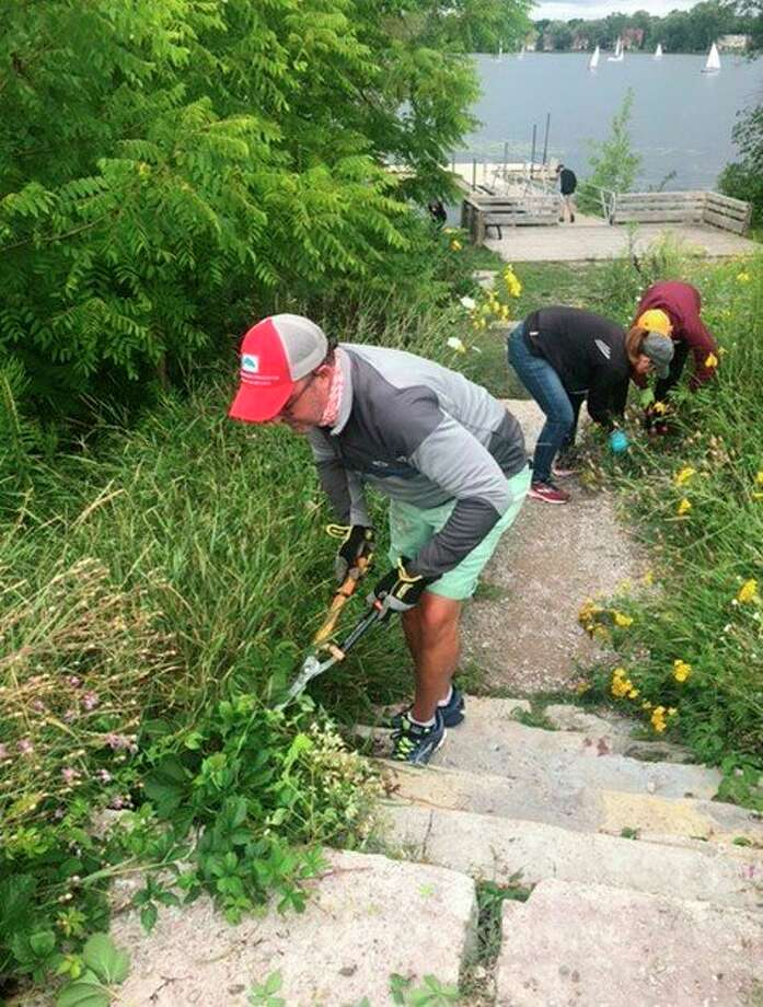 West Shore Bank employees did a variety of volunteer projects, such as cleaning the TART Trail, during West Shore Bank's newly created Acts of Kindness Week. (Courtesy Photo)
