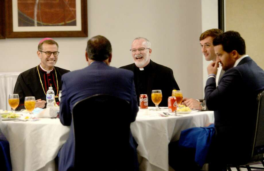 Bishop-elect David Toups talks with family at the luncheon before his ordination at St. Anthony Cathedral Basilica. Photo taken Friday, August 21, 2020 Kim Brent/The Enterprise Photo: Kim Brent/The Enterprise
