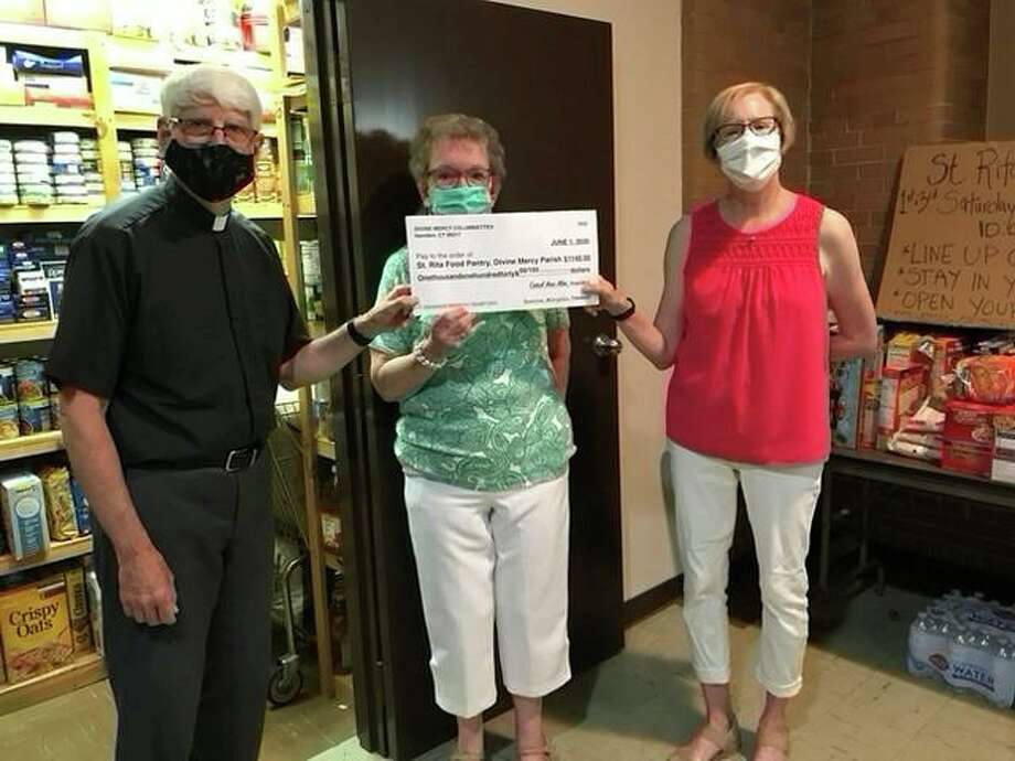 Monsignor Joseph D'Sciacca, left, pastor of Divine Mercy Parish and Harriet Hyde, center, Food Pantry Coordinator, receive a check for $1240.00 from Columbiette Ann Bruchansky to support the St. Rita Food Pantry of Divine Mercy Parish, 1620 Whitney Ave. Photo: Divine Mercy Parish / Contributed Photo