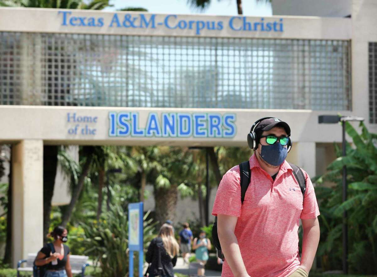 Students wear masks as they walk to class on the first day of the fall semester at Texas A&M University Corpus Christi last week.