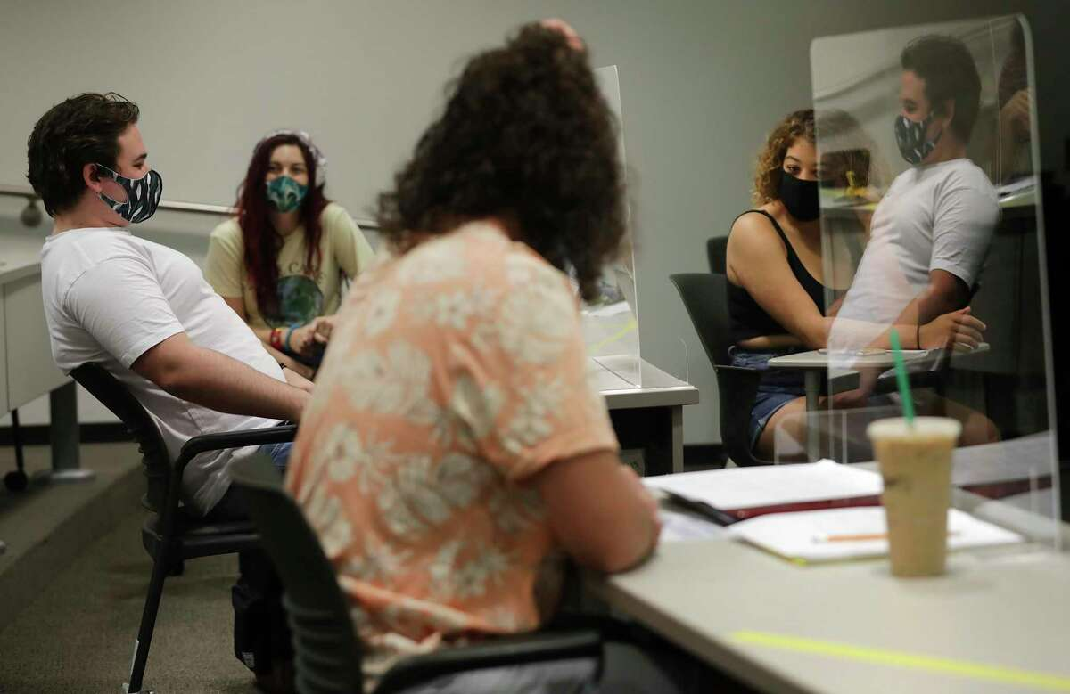 Students wearing masks and sitting behind plastic shields attend the first day of a senior theater class at Texas A&M University Corpus Christi last week.