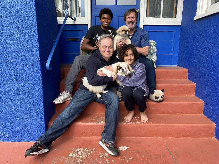 The Fisher-Paulson pose outside their home in the outer, outer, outer, outer Excelsior area of San Francisco. Photo: Courtesy Of Kevin Fisher-Paulson