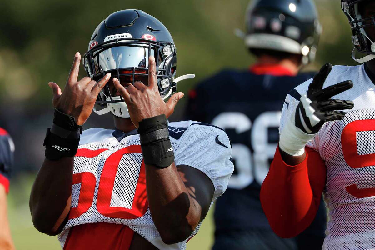 Houston Texans linebacker Tyrell Adams gestures while warming up during an NFL training camp football practice Friday, Aug. 21, 2020, in Houston.