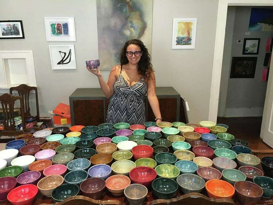 Passion Trenkelbach poses with ceramic bowls she crafted for Empty Bowls Houston, a fundraiser for the Houston Food Bank. The bowls are available for $25 each at Serenity Studios in the Heights. Each donation provides 75 meals for people in need in the Houston area. Photo: Courtesy Photo