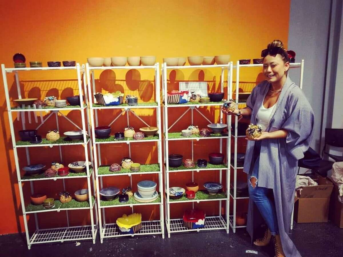 Michelle Heinesen poses with ceramic bowls she made for Empty Bowls Houston, which raises money for the Houston Food Bank. A $25 donation gets a bowl and provides 75 meals for people in need in the Houston area.
