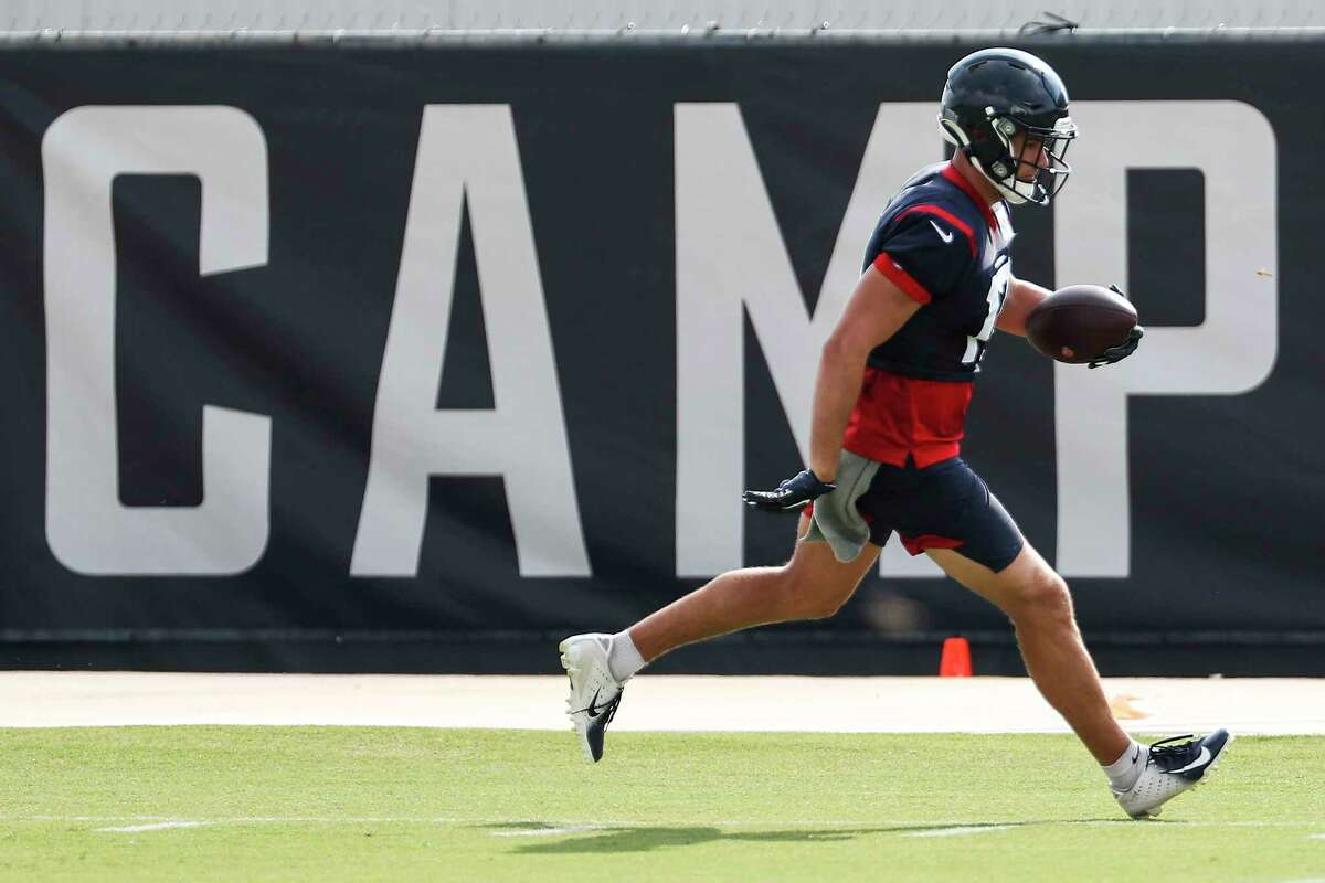 Houston Texans wide receiver Chad Hansen (17) runs the ball upfield after making a catch during an NFL training camp football practice Friday, Aug. 21, 2020, in Houston.