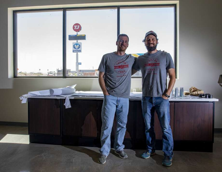 Zach, left, and Seth Covington pose Aug. 11, 2020 inside the restaurant part of the new Tarzan and Jane Gas and Grill in Stanton. Photo: Jacy Lewis/Reporter-Telegram / MRT