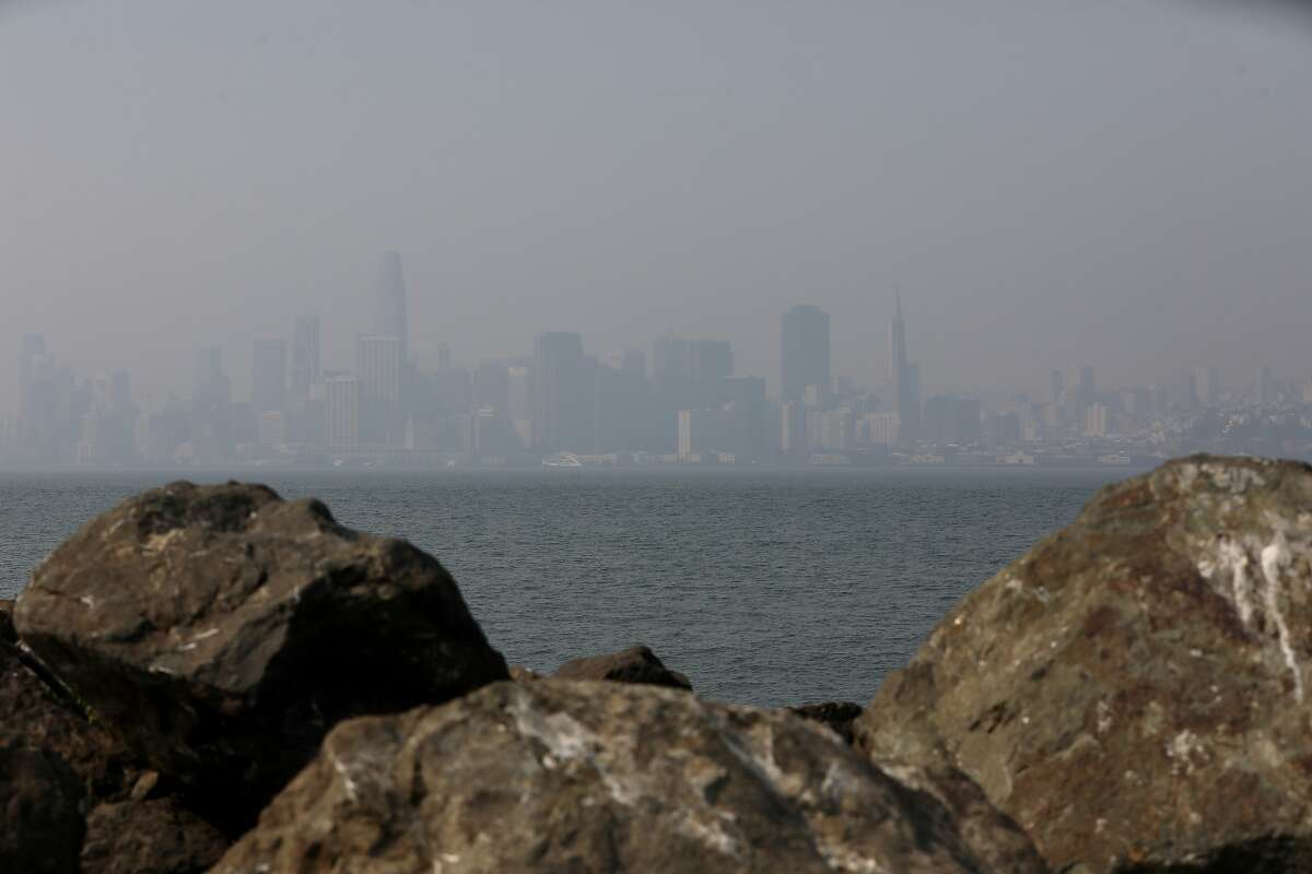 A smoky haze from multiple wildfires in the Bay Area continues to cover the San Francisco skyline as seen from Treasure Island, Calif., on Friday, August 21, 2020.