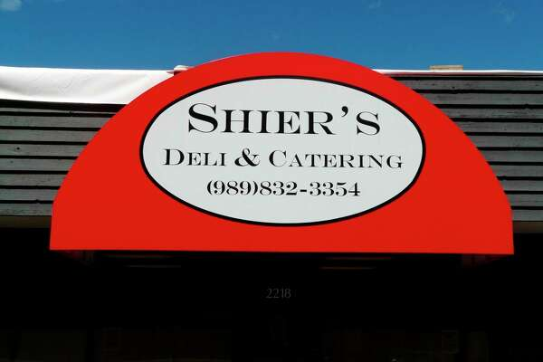The distinctive red storefront awning of Midland business, Shier's Deli & Catering. The Midland family-owned business is a MDN Readers' Choice Award winner, taking home a silver for best caterer and a bronze for best sandwich. (Photo by Jon Becker)