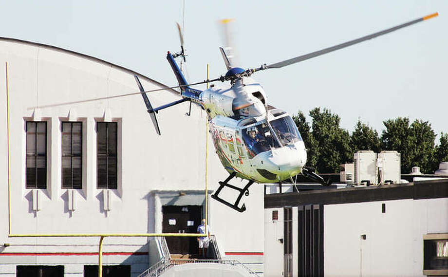 An ARCH Air Medical Services Inc. helicopter ambulance lifts off Friday from the Roxana High School football field headed for St. Louis University Hospital in St. Louis with a seriously ill staff member. Roxana firefighters and Alton Memorial Ambulance responded to a call at the Roxana Junior High School for an unconcious, 30-year-old staff member who was suffering from a diabetes-related issue. Rescue workers called for the helicopter and met it on the football field. Roxana firefighters set up a landing zone, as many people in the neighborhood came out or stopped their cars to watch the helicopter land and lift off. No further information was available about the staff members condition Friday.
