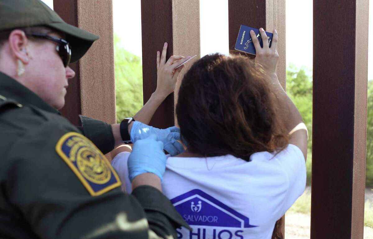 U.S Border Patrol Agent Amber Peterson pats-down a woman from El Salvador, in Hidalgo County near McAllen, Texas, Thursday, July 19, 2018. The woman was with a group of seven immigrants from Central America, turned themselves into authorities after illegally crossing the Rio Grande into the U.S. The group included family units.