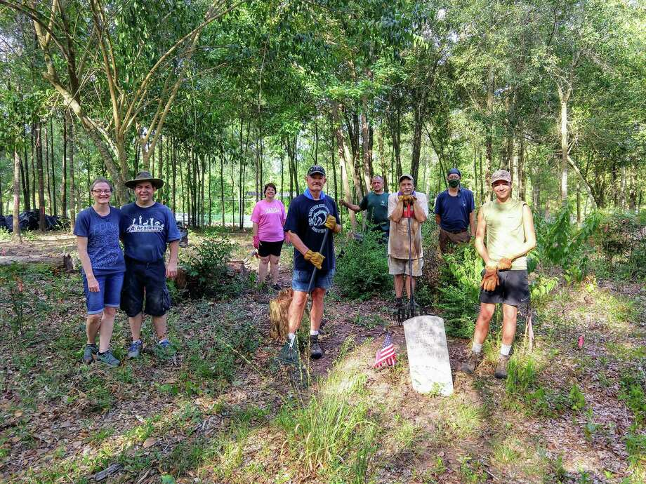 Saturday Carson recruited nine workers to help with his Eagle Scout Project.  Family units worked together and others socially distanced. Everyone is standing by Luther Dorsey's grave.  Luther Dorsey is the only known Buffalo Soldier buried in Montgomery County. Pictured from left are Heather & Paul Jacobs, Robin Pyle, Brad Wheeler, J. R. Jones, Hunter Pyle, John Meredith & Carson Pyle Photo: Courtesy Photo