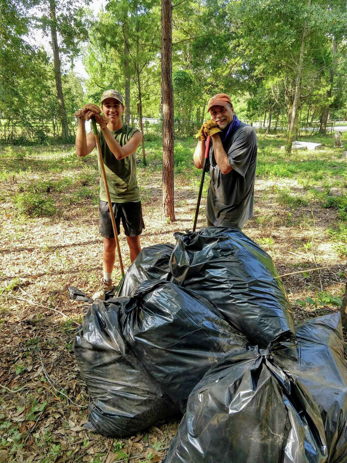 Carson and Hunter Pyle are bagging the leaves and debris which later in September will be emptied into a dumpster provided free of charge by Waste Management.