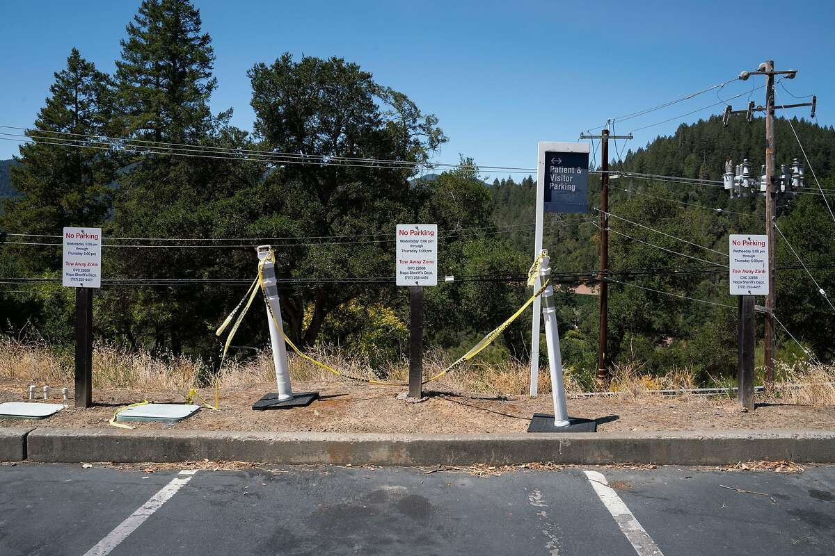 Parking spots at Saint Helena Medical Center are unoccupied due to fire evacuations in St. Helena, Calif. on Friday, Aug. 21, 2020.