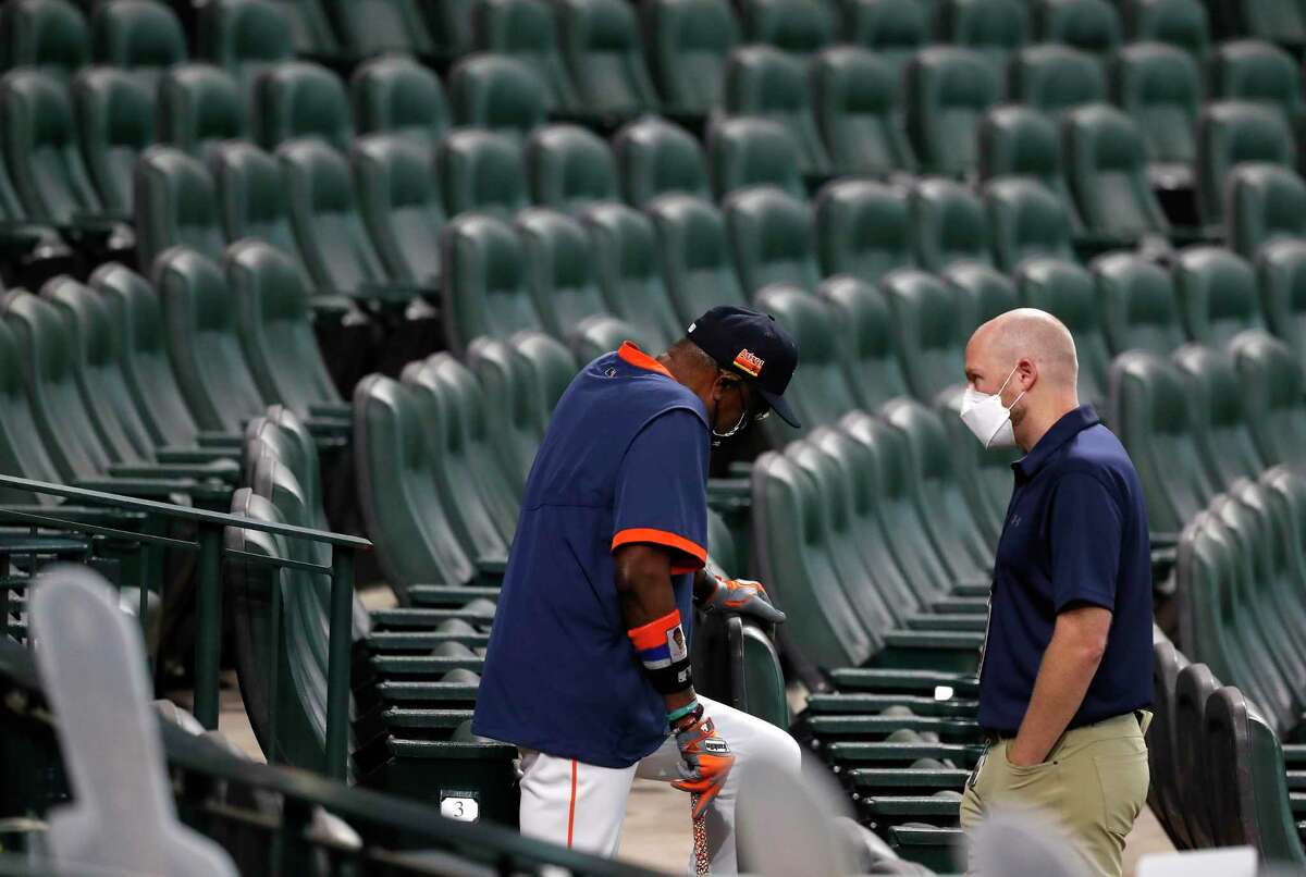 Astros General Manager James Click, talking with manager Dusty Baker earlier this season, faces many questions as trade deadline approaches.