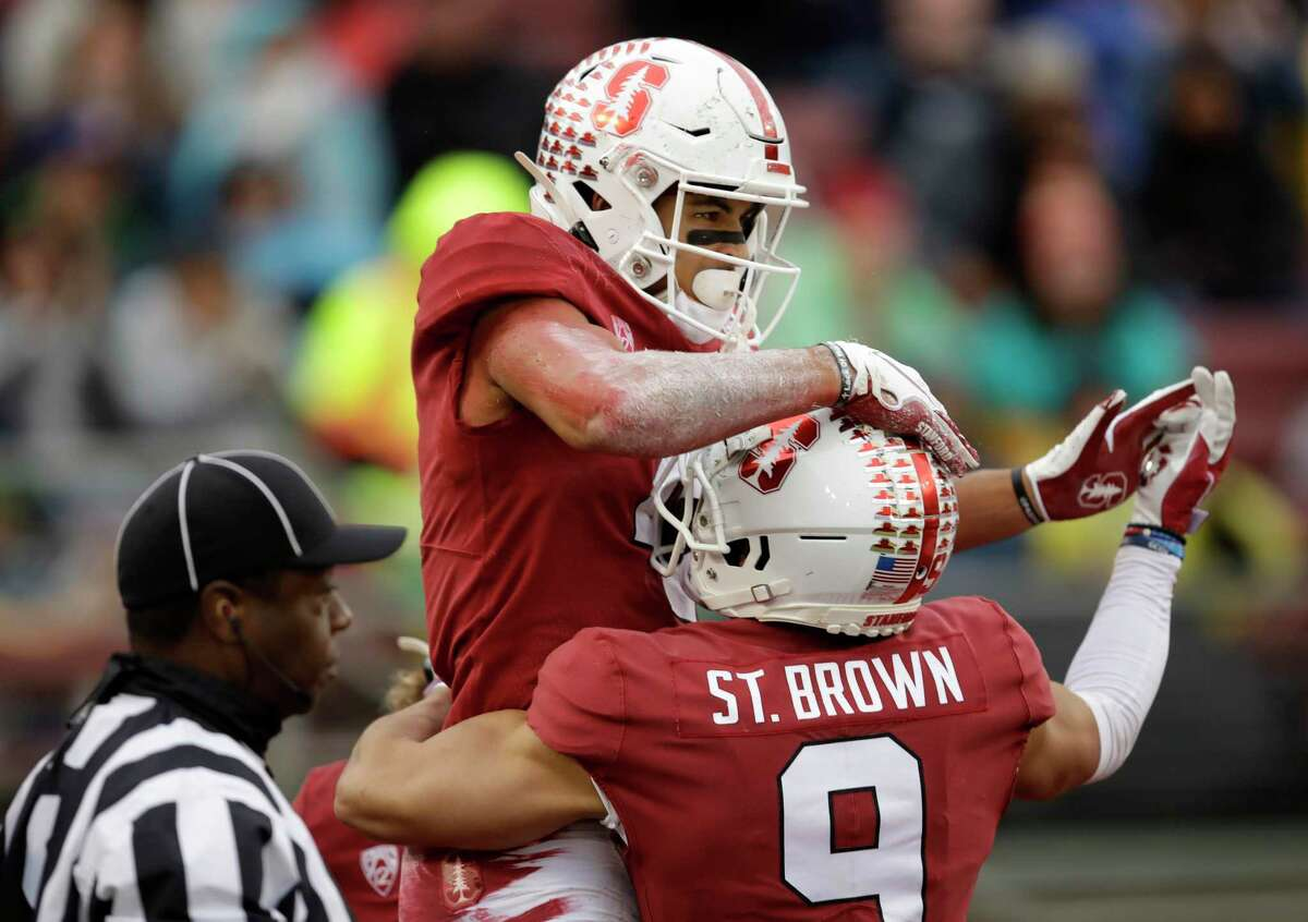 Stanford players celebrate a touchdown last year in a scene college teams are unlikely to experience this fall. But the reason isn't concern for the safety of players.