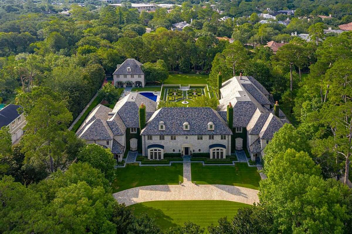 The 26,000 square-foot home comes with beautiful amenities, including six bedrooms, seven bathrooms, a guest house, a circular motor court with a six-car garage, sport court, and playground. The real estate company shared a video tour of the home.